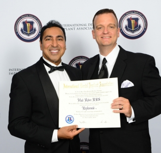 Dr. Rider receving his Diplomate Certificate from Dr. Garg
